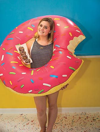 Donutz on a stick girl in an inflatable donut ring